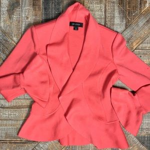 St. John wool coral cardigan with flare at wrists.